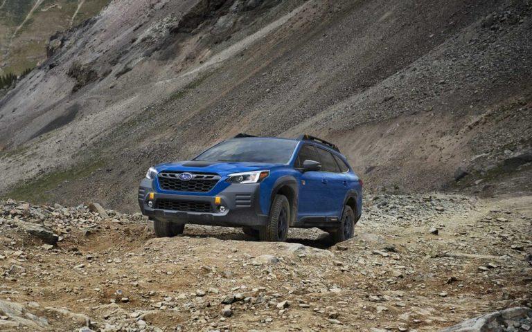 Subaru Outback Wildernes Edition on a rocky landscape.