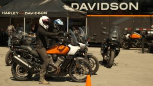 Two women ride adventure motorcycles at Overland Expo