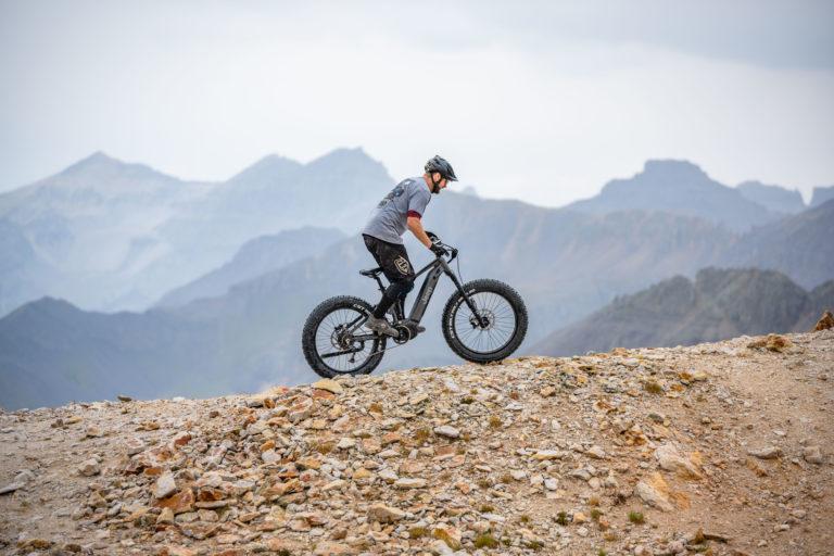 QuietKat bike rider ascending a ridgeline.