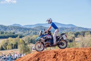 Motorcyclist crossing a dirt berm