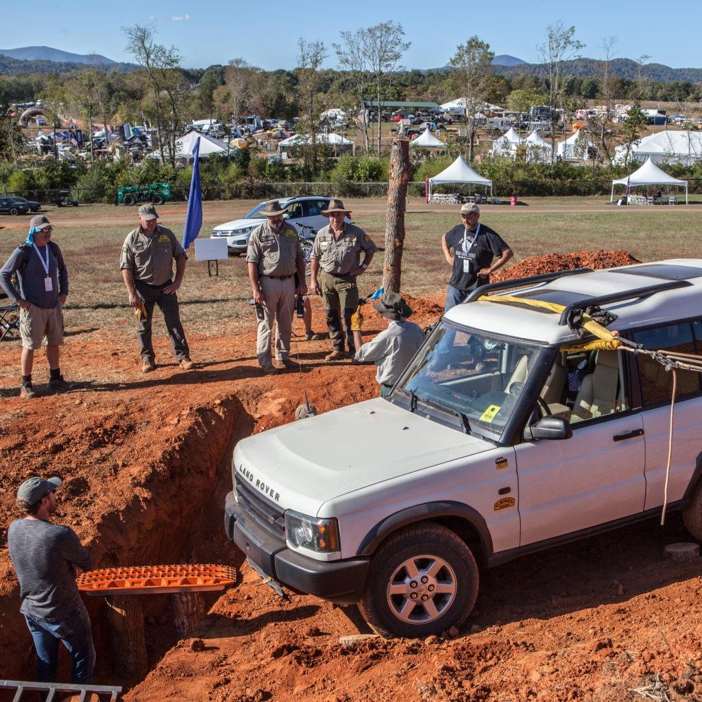 Trainers discuss crossing a gap using improvised bridge materials.