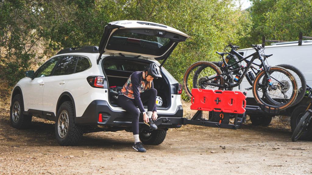 UltraSwing holding extra fuel and a bike rack accessory on a Subaru.