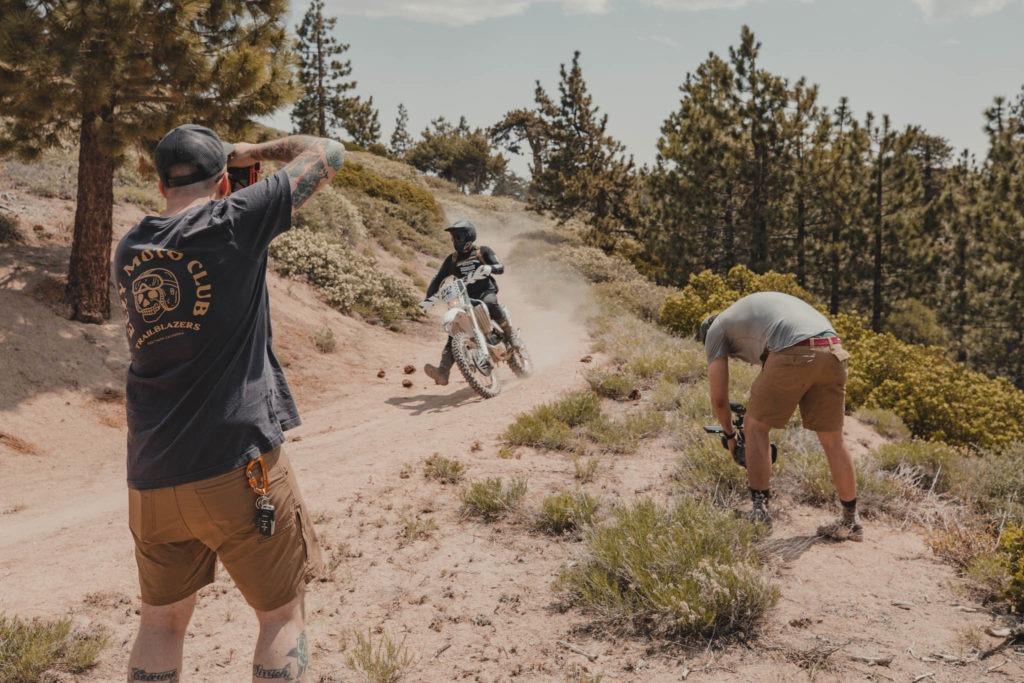 Camera crew films dirt biker riding